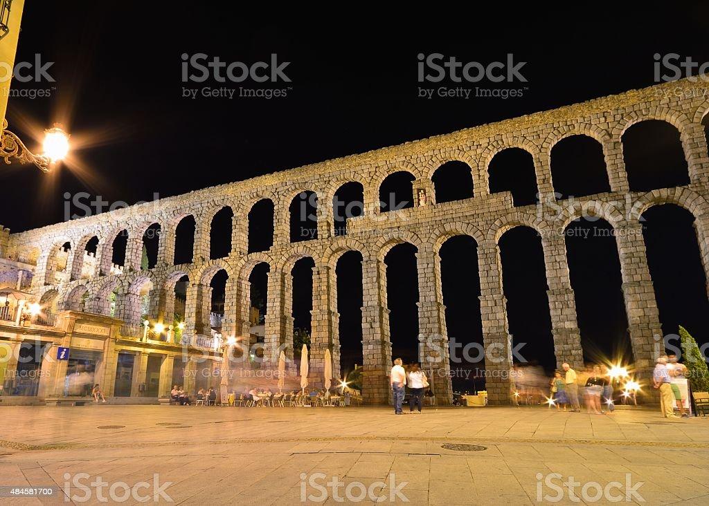 Night view of aqueduct of Segovia, Spain. stock photo