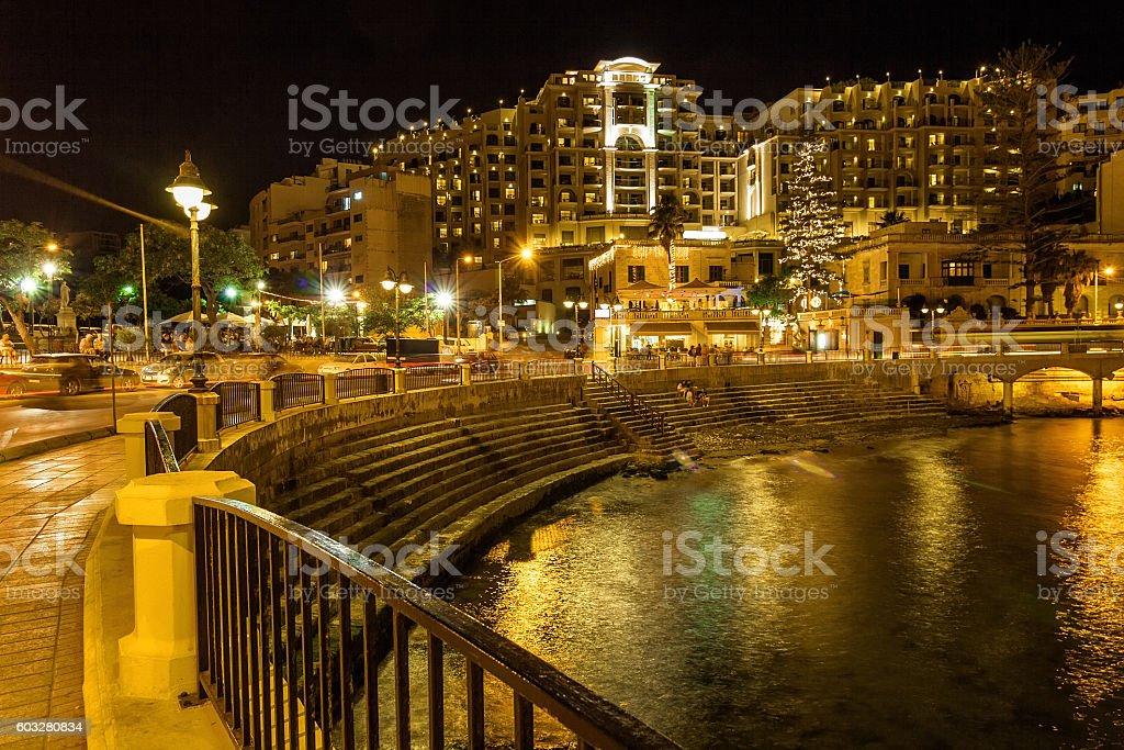 Night view of Balluta Bay in San Julien, Malta. stock photo