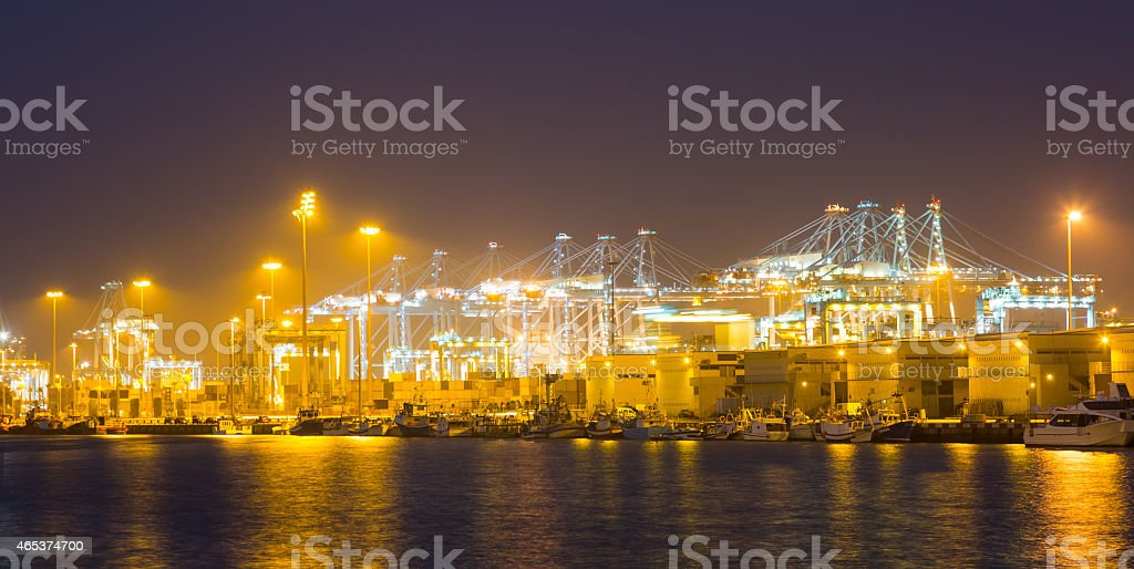 night  view of   cranes and containers in cargo seaport stock photo