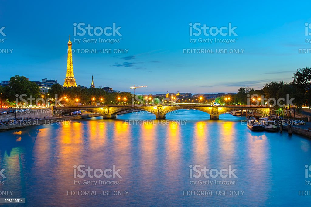 Night view of Eiffel Tower and Pont des invalides stock photo