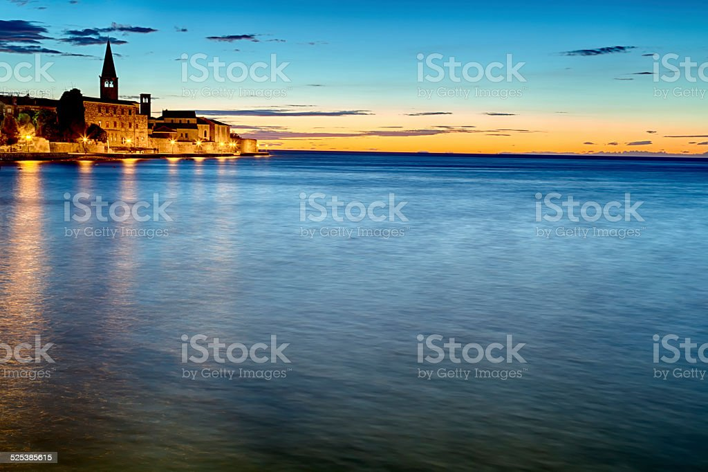 Night view of European village by the sea stock photo