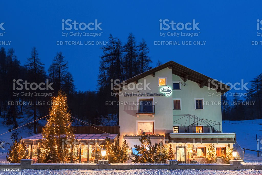 Night view of house with lighting Christmas tree in front stock photo