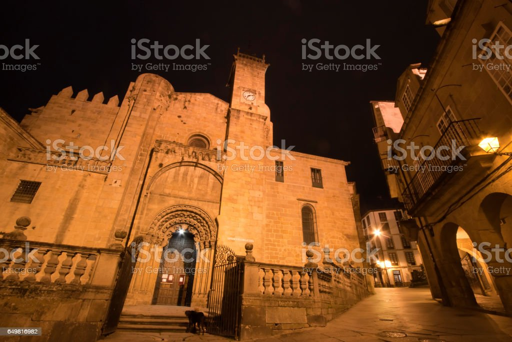 Night view of old town pedestrian street and cathedral facade in Ourense, Galicia, Spain. stock photo