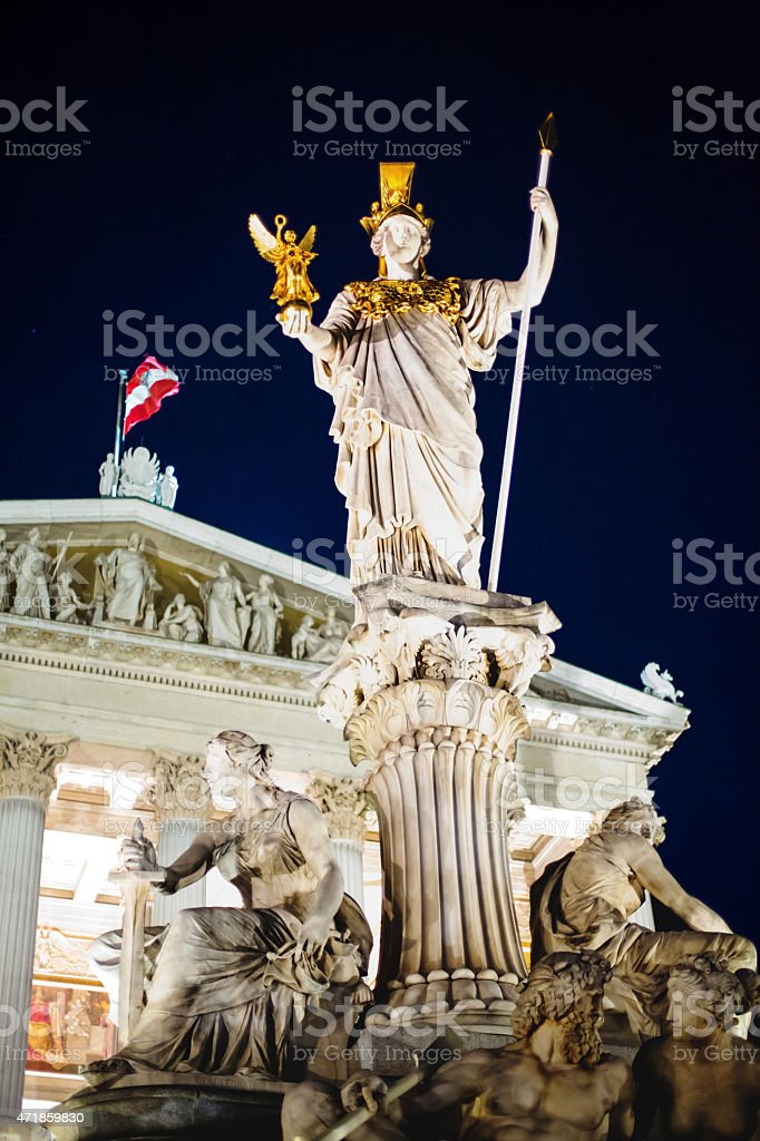 Night view of Parliament and Athena statue in Vienna, stock photo