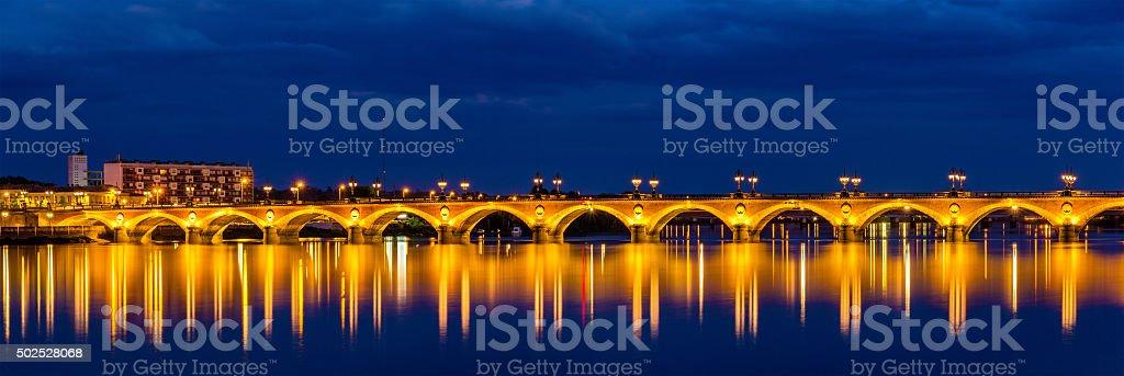 Night view of Pont de pierre in Bordeaux - France stock photo