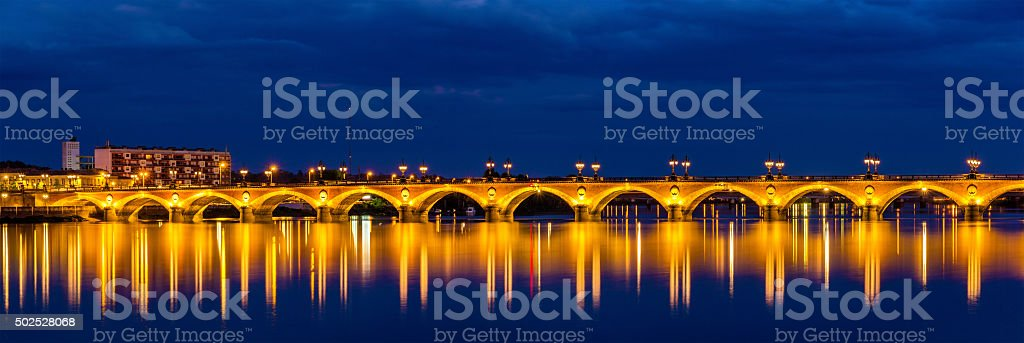 Night view of Pont de pierre in Bordeaux - France stock photo