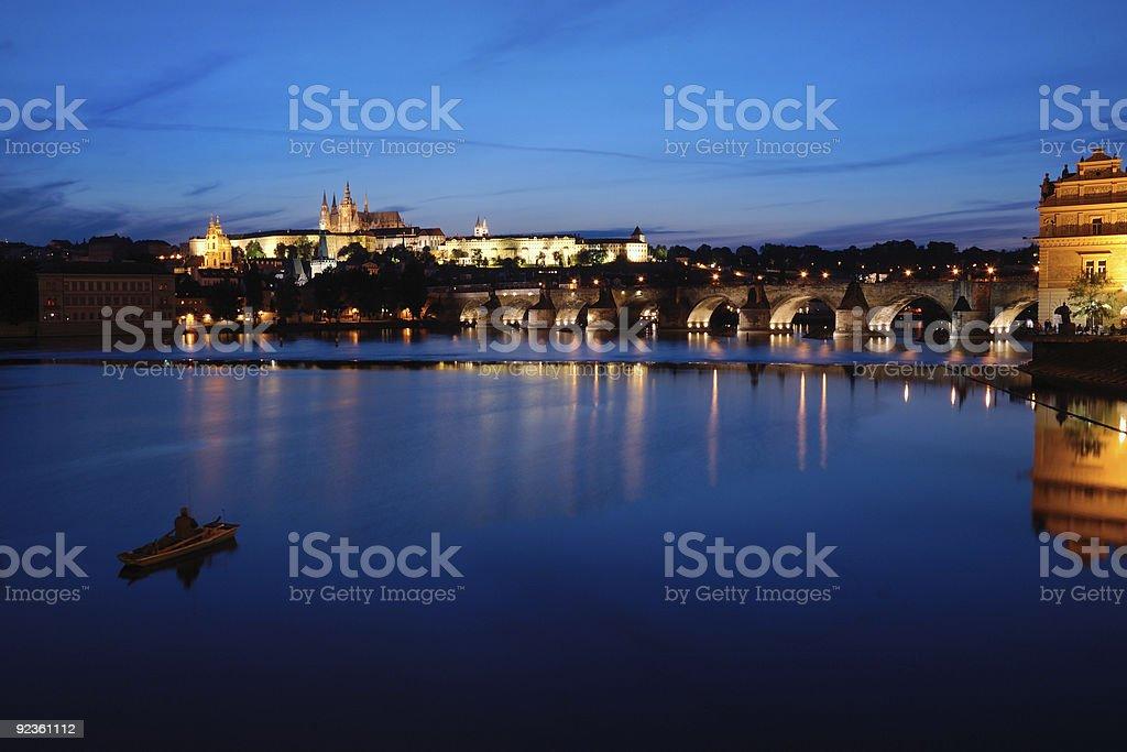 Night view of Prague castle, bridge and Vltava river royalty-free stock photo
