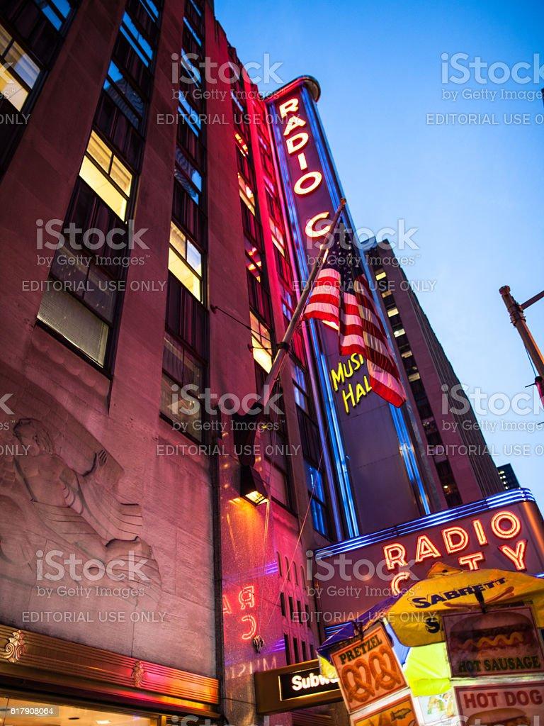 Night view of Radio City Music Hall and food cart stock photo