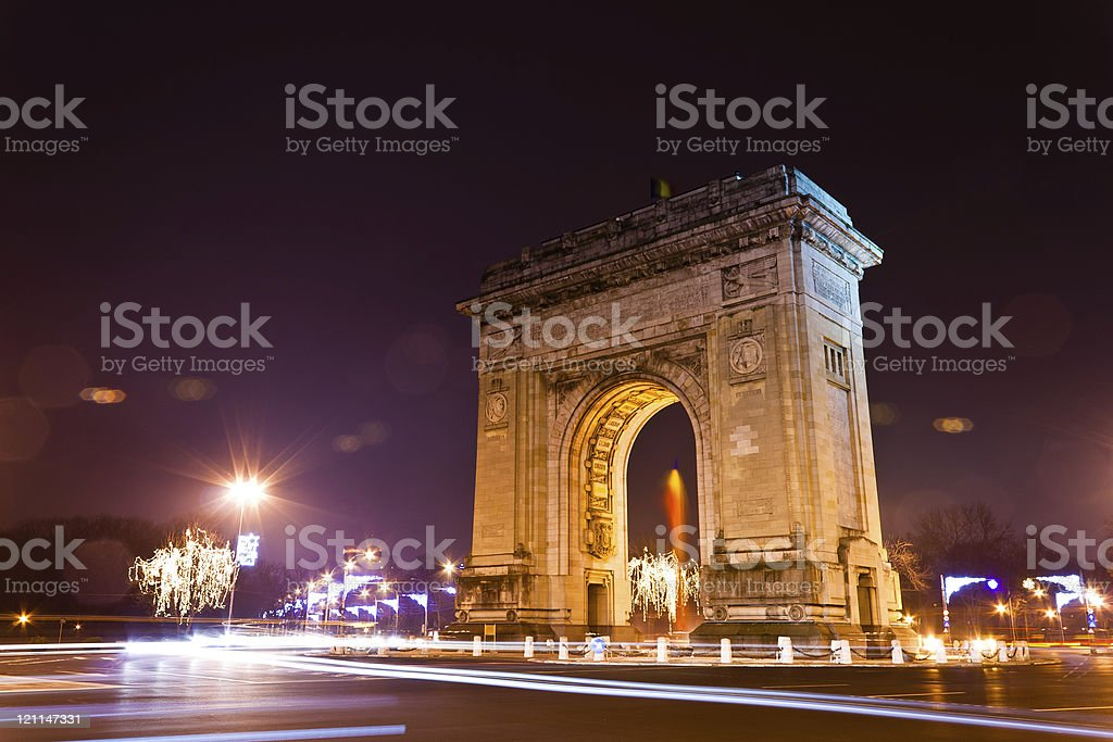 Night view of the Arch of Triumph in Paris stock photo
