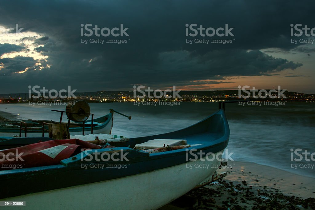 Night view of the city, the sea, the beach stock photo