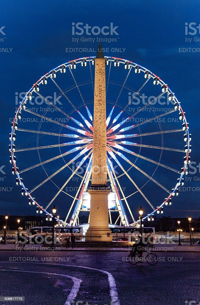 Night view of the Ferris Wheel and Obelisk in Paris stock photo