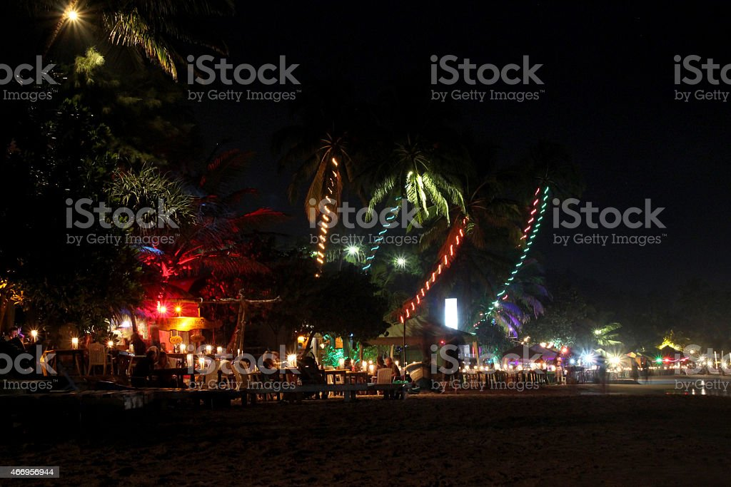 night view of the Mirissa beach with illuminated palm trees royalty-free stock photo