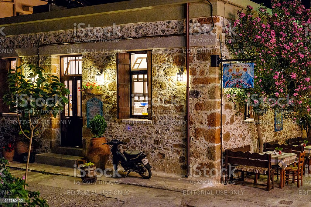 Night view of traditional greek tavern stock photo