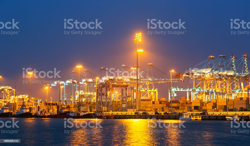 night view of  with cranes and containers in port stock photo