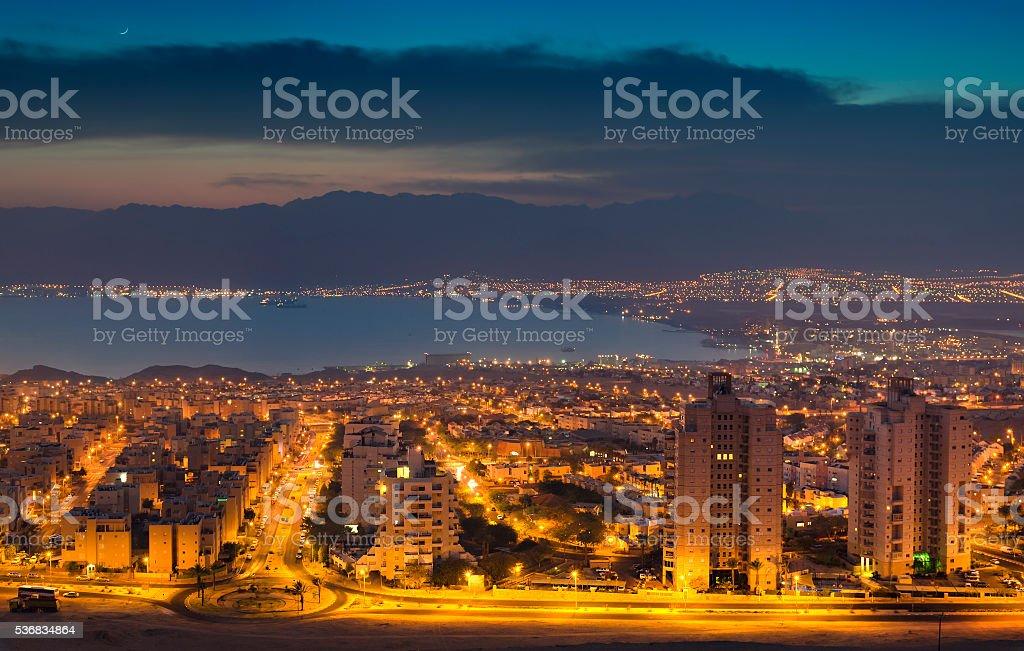Night view on Eilat and Aqaba Gulf, Israel stock photo