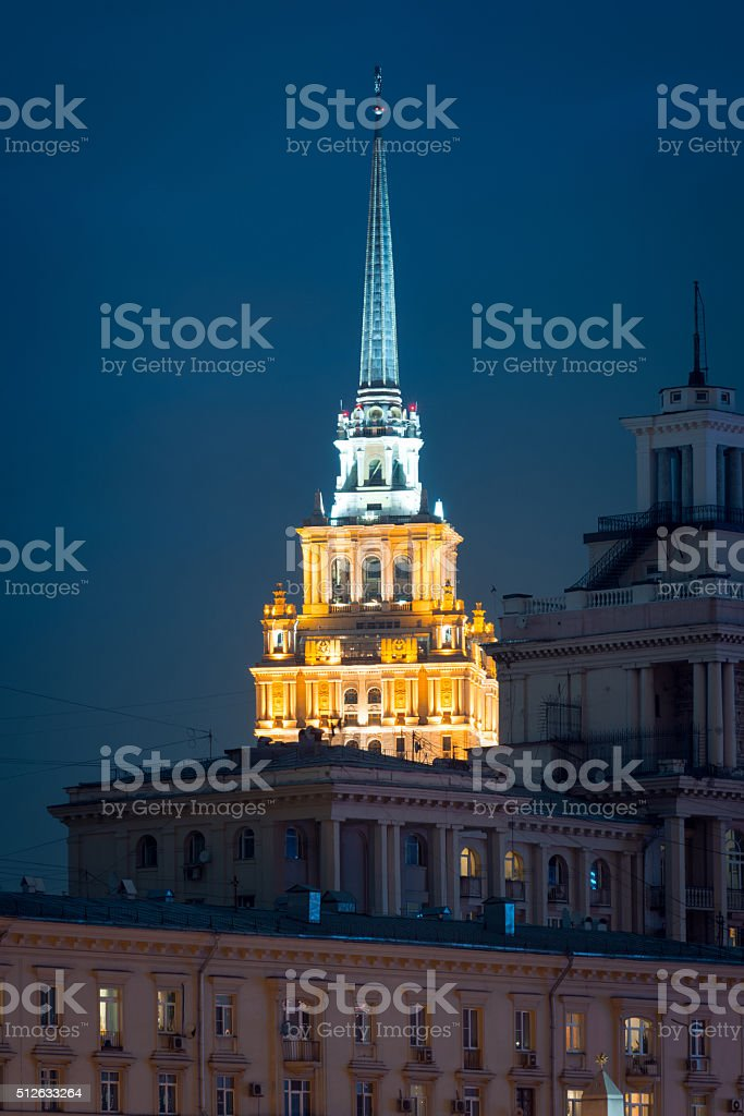 Night view on hotel Ukraine behind the buildings stock photo