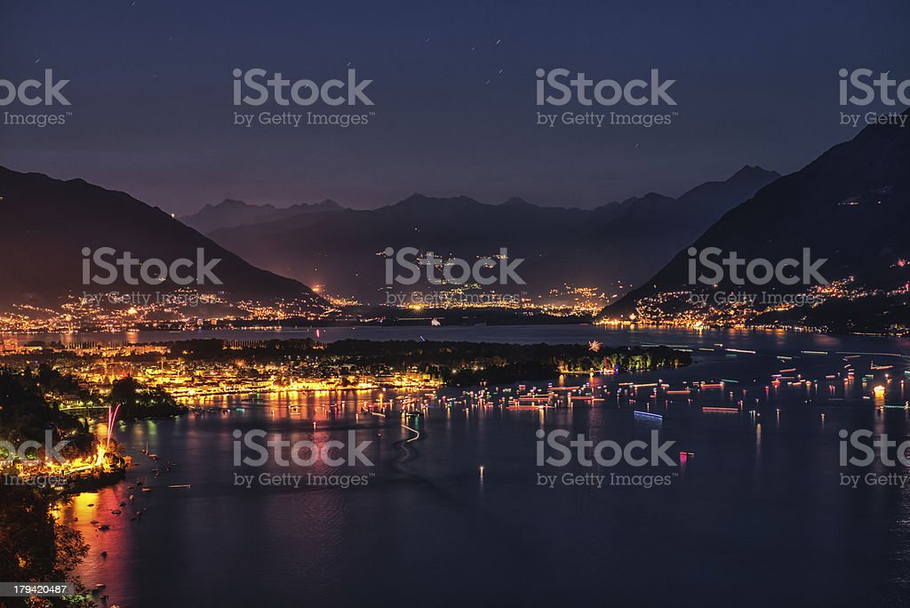 night view over lake maggiore on swiss national holiday stock photo
