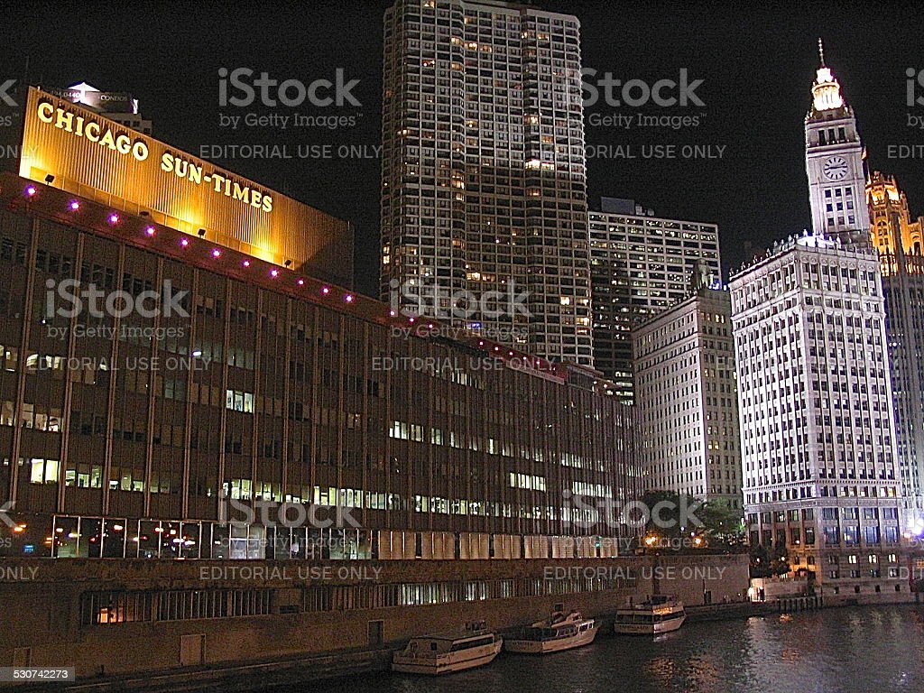 NIght view toward old Sun-Times Building, Wrigley Building clock tower stock photo