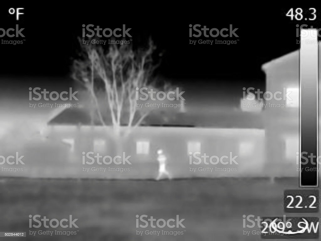 Night vision thermal image of a running man stock photo