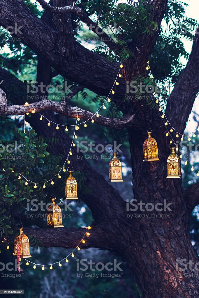 Night wedding ceremony with a lot candles and vintage lamps stock photo
