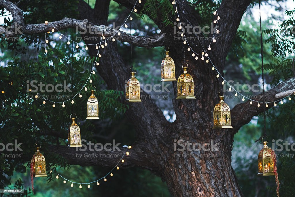 Night wedding ceremony with lot of candles and vintage lamps stock photo