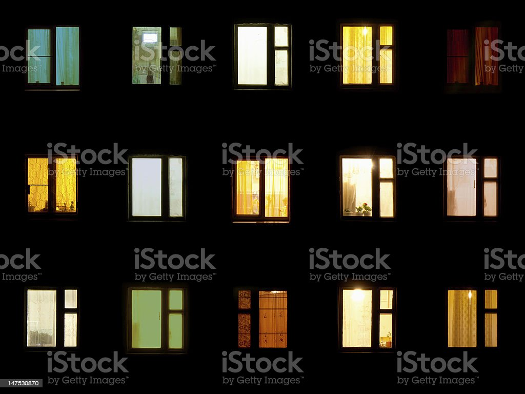 Night windows - block of flats background stock photo