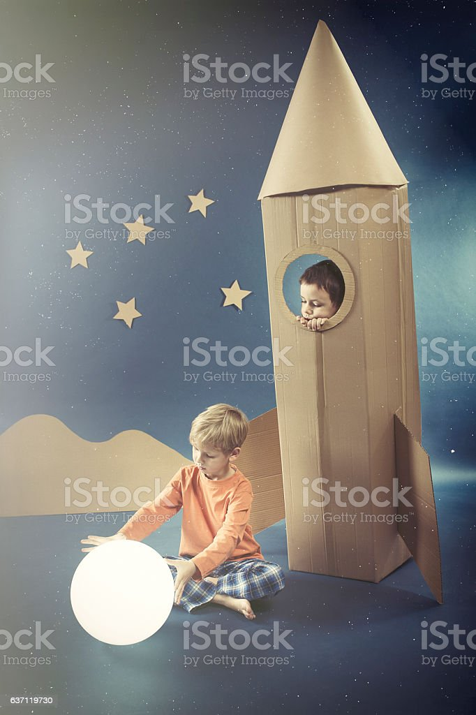 Night with boy in rocket stock photo