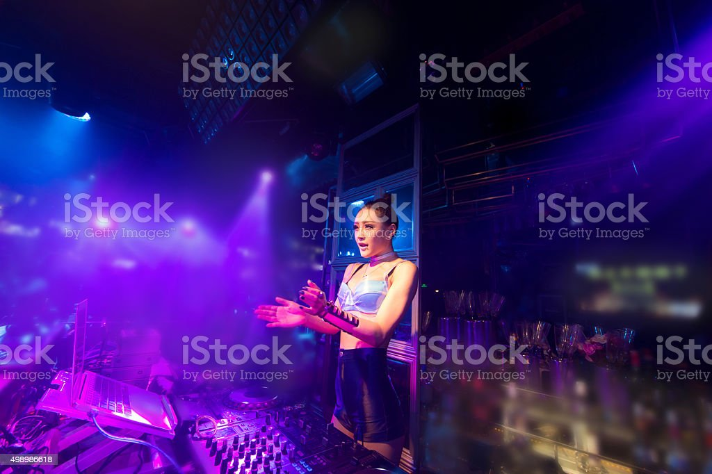 nightclub party DJ woman stock photo