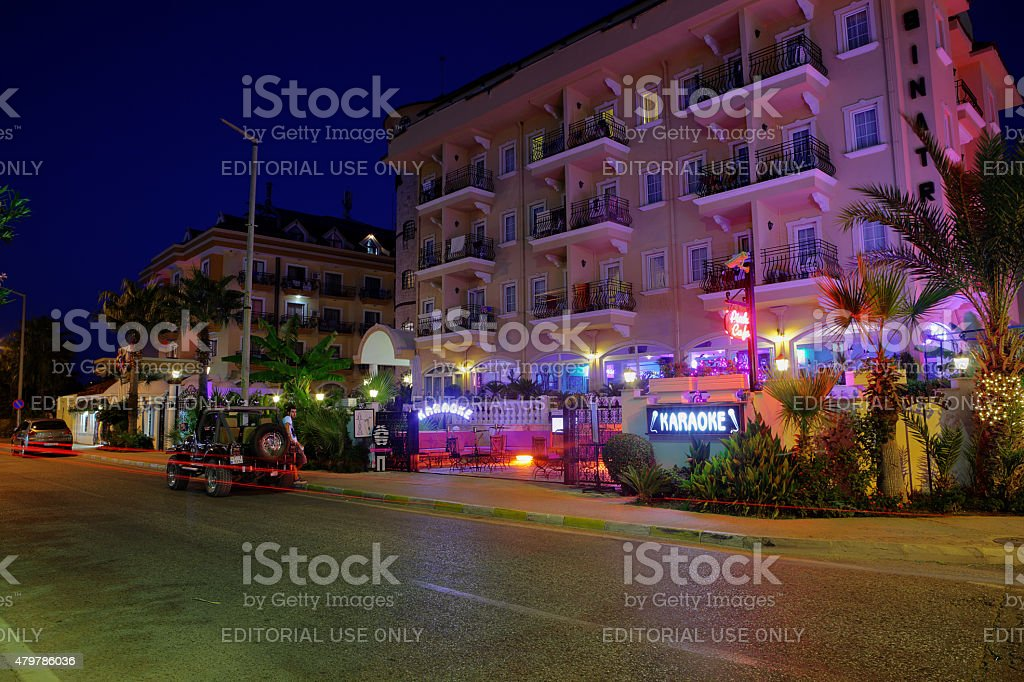 Nightlife in resort settlement, colorful lighting building facade of hotel. stock photo