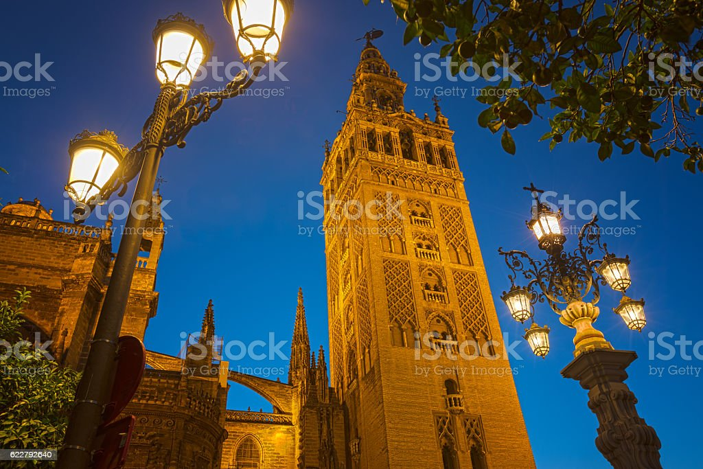 Nightly view of the cathedral of Seville, Spain stock photo