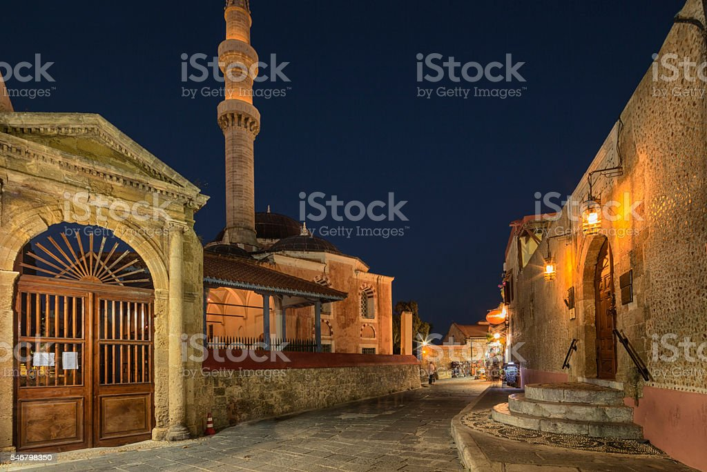 Nightshot of a Street and Suleymaniye Mosque in Rhodes, Greece stock photo