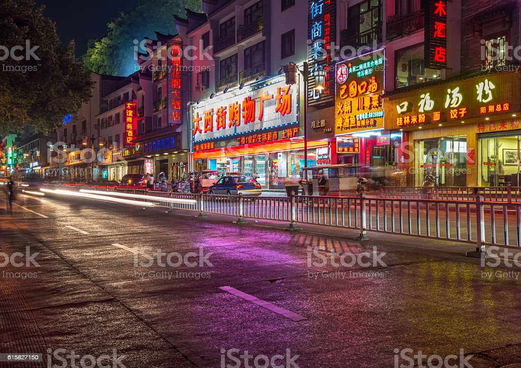 Nightshot of main road  in Yangshuo, China. stock photo