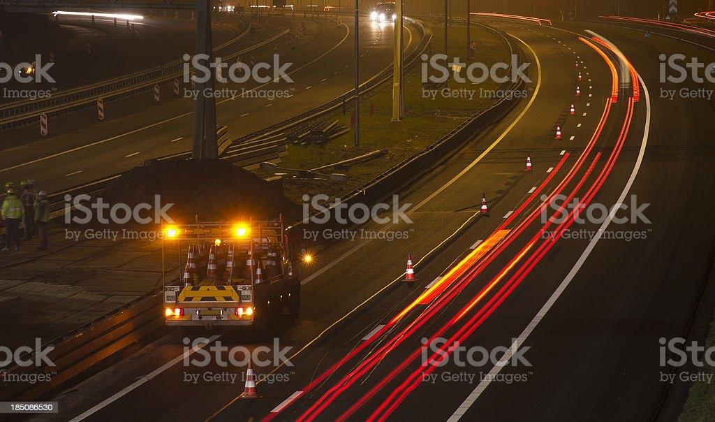 Nighttime Highway Maintenance stock photo