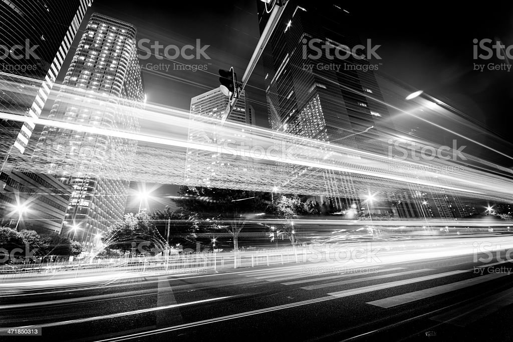 A nighttime images of traffic moving through the streets royalty-free stock photo