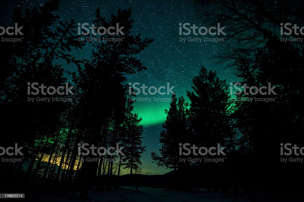 A nighttime scenic view of the Northern Lights in Sweden stock photo