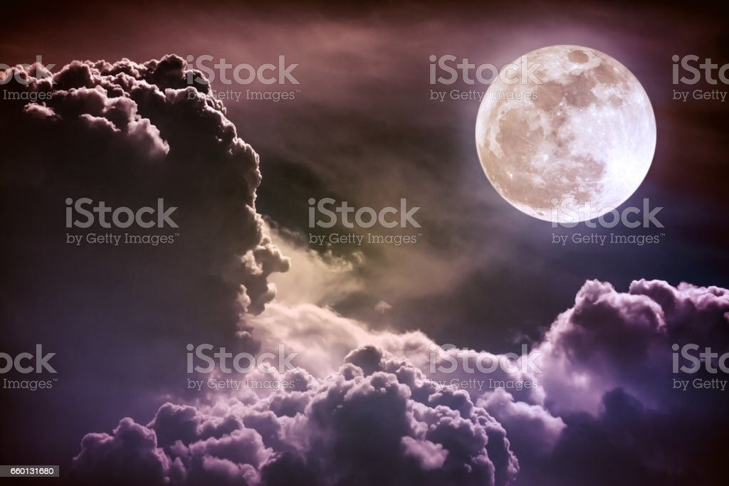 Nighttime sky with clouds and bright full moon. Vintage tone. stock photo