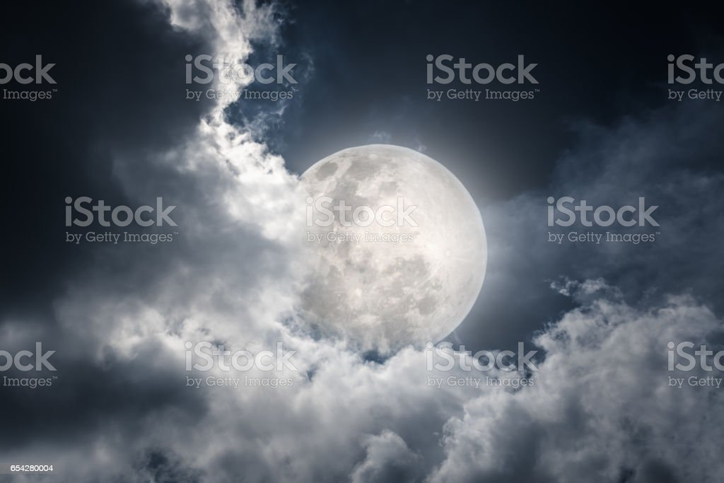 Nighttime sky with clouds and full moon. Vintage tone effect. stock photo