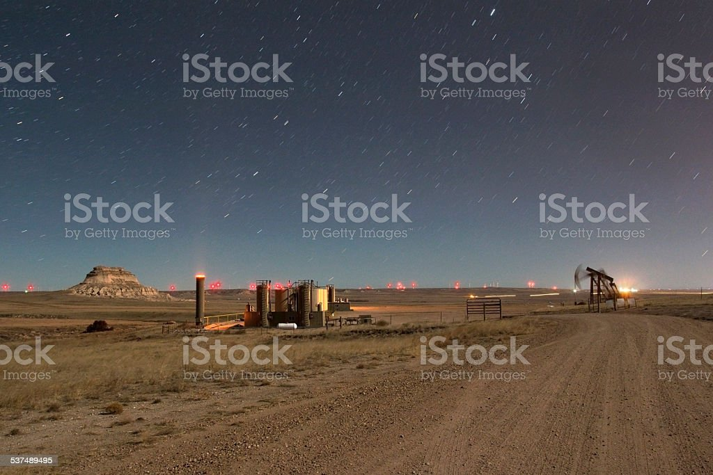 Nighttime stars over petroleum production and Pawnee Buttes Colorado stock photo