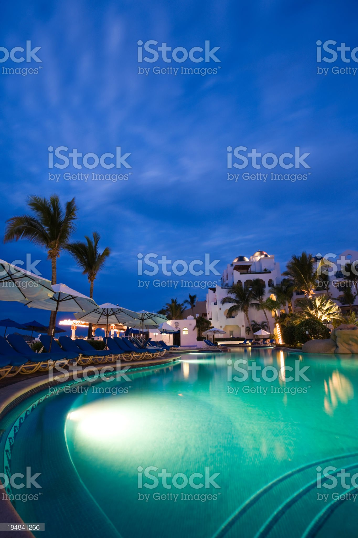 Nighttime swimming pool and resort in Cabo San Lucas, Mexico royalty-free stock photo
