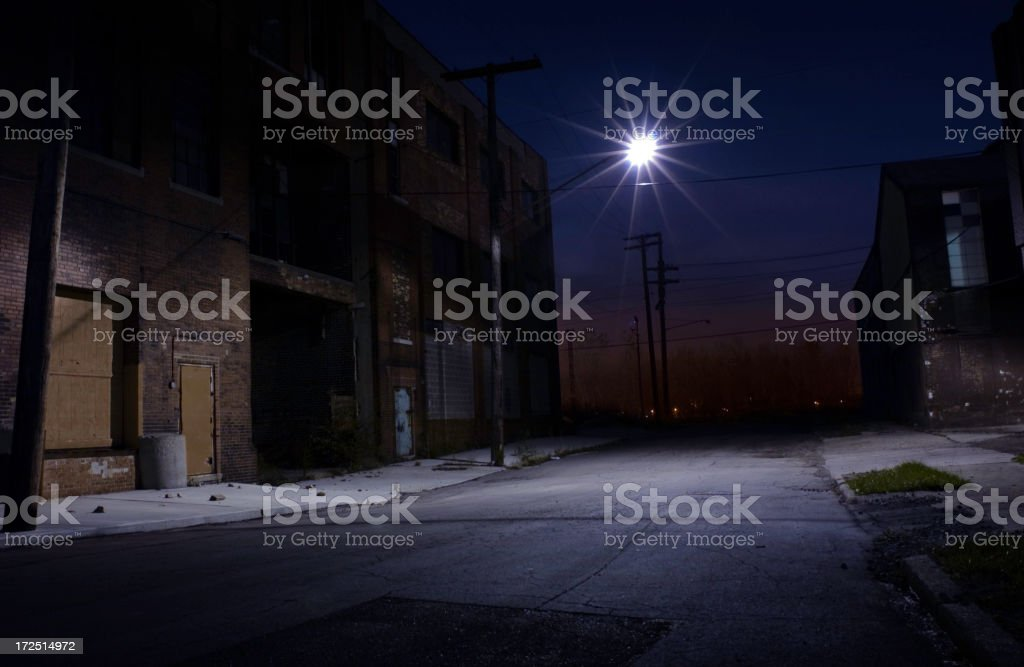 Nighttime view of an empty side street under a streetlight stock photo