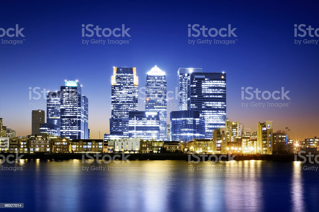 Nighttime water view of the lit up Canary Wharf in London stock photo