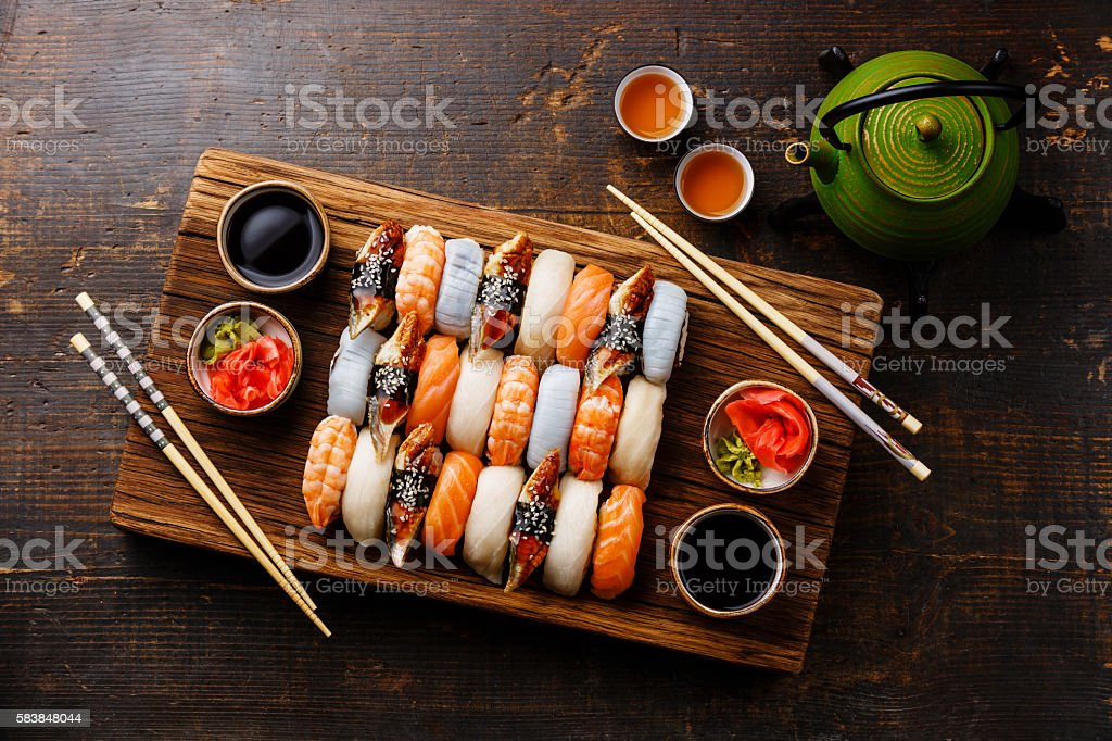 Nigiri sushi set for two and green tea stock photo