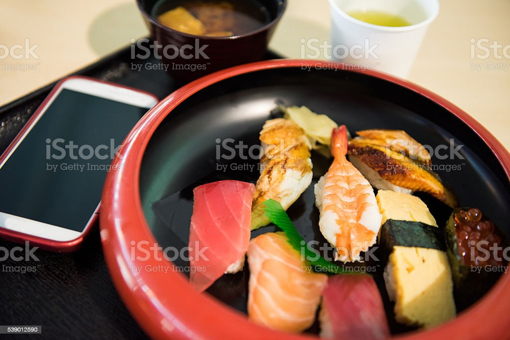 Nigiri Sushi set with a smart phone stock photo