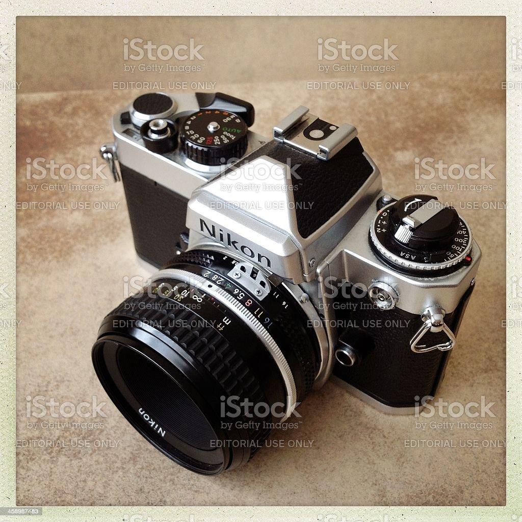 nikon fe camera with 50mm lens royalty-free stock photo