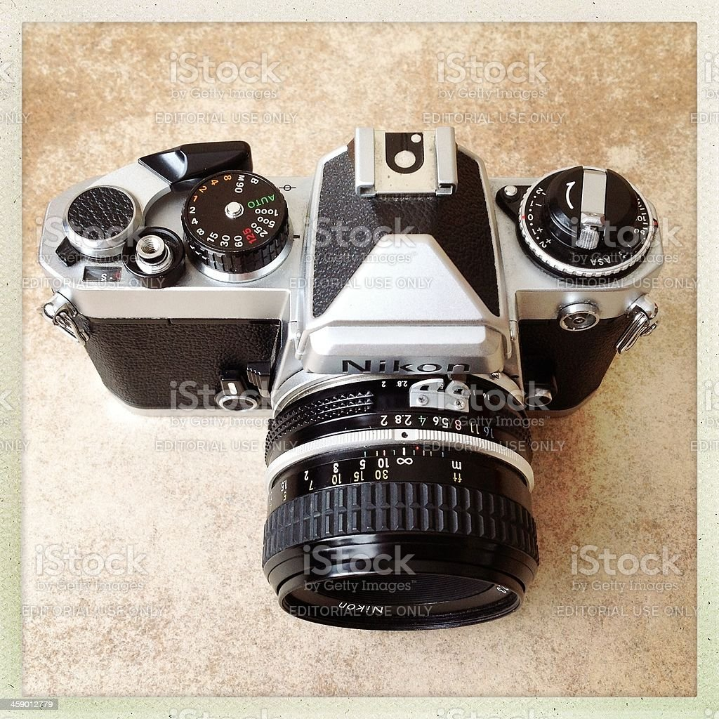 nikon fm camera with 50mm lens royalty-free stock photo