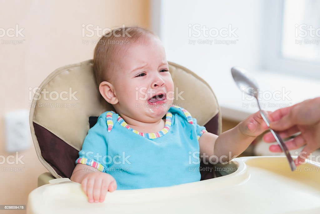nine baby cries before feeding at home stock photo