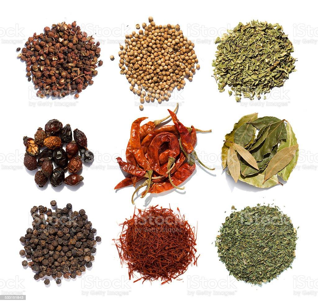 Nine coloured spices stock photo