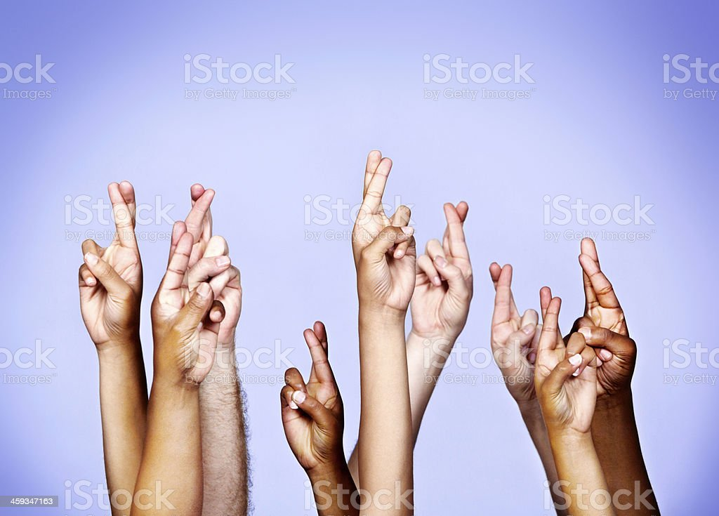 Nine mixed hands are raised against a sky blue background, all with...