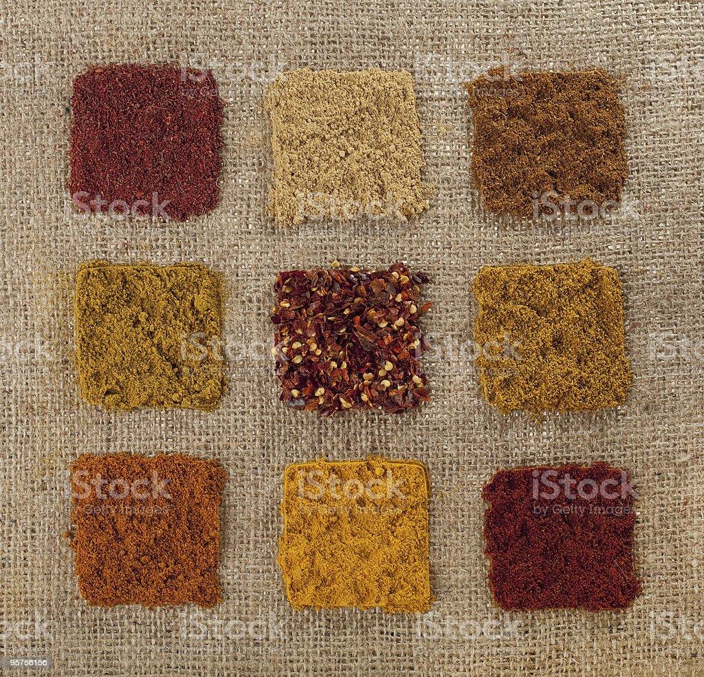 nine indian spice on hessian backdrop royalty-free stock photo