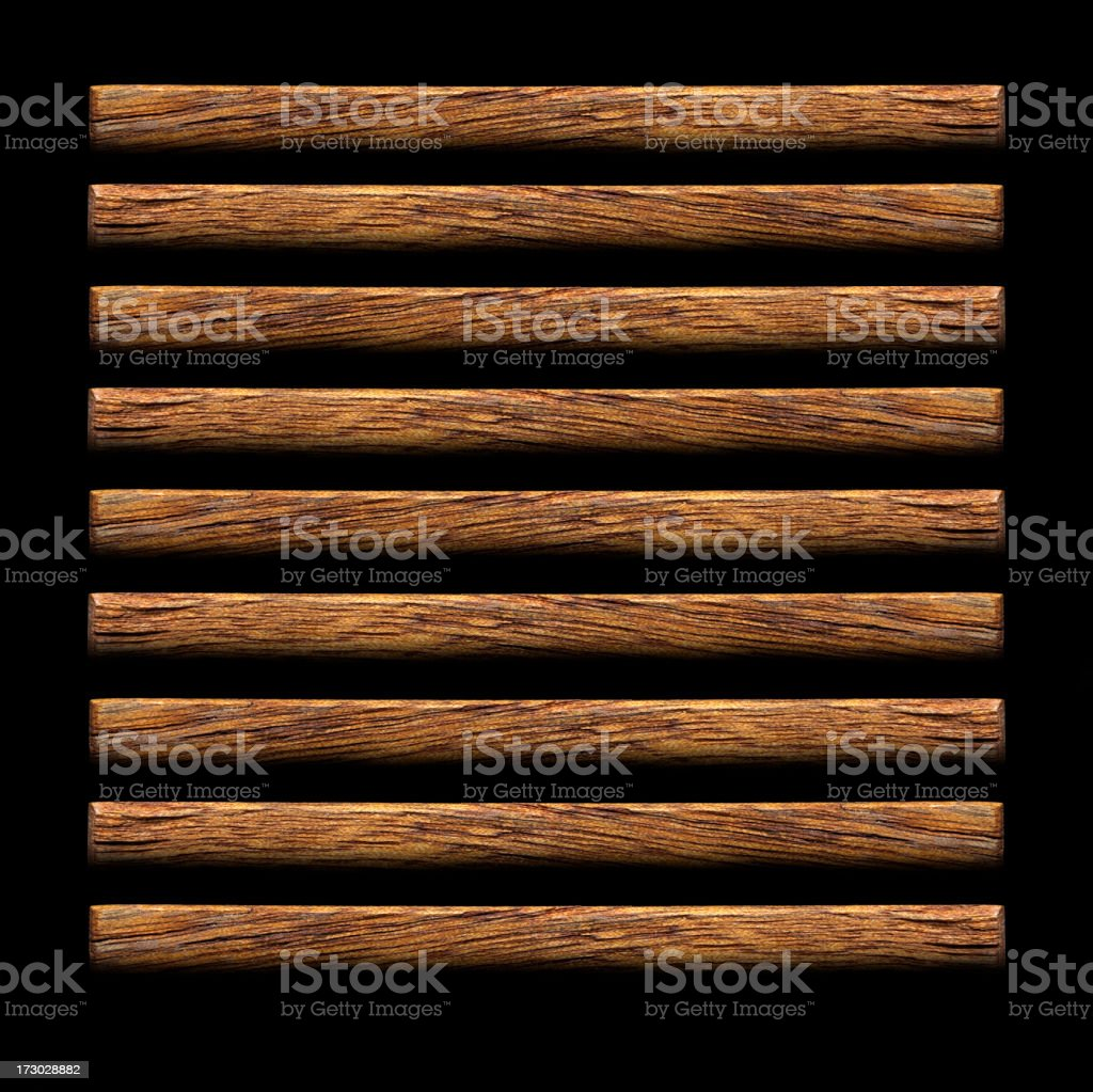 Nine individual wooden planks on a black background royalty-free stock photo